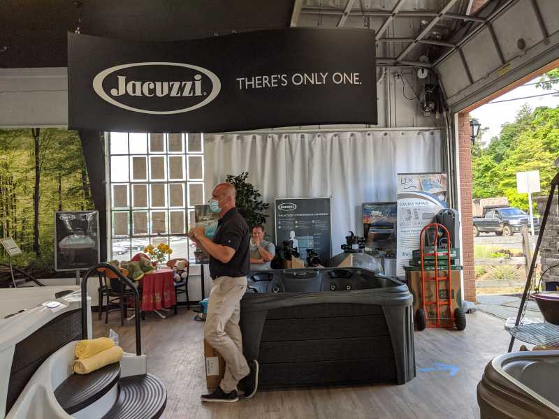 Dennis Gentek, a Jacuzzi representative training Rin Robyn Pools staff in the Chester, New Jersey retail location